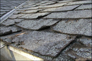 Replacement of sections of badly damaged shingles
